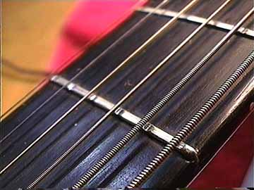 Look At The Deep Grooves Worn Under Bass Strings Just About ONLY Way Can Wear Out Frets Faster Than Treble Is With Heavy